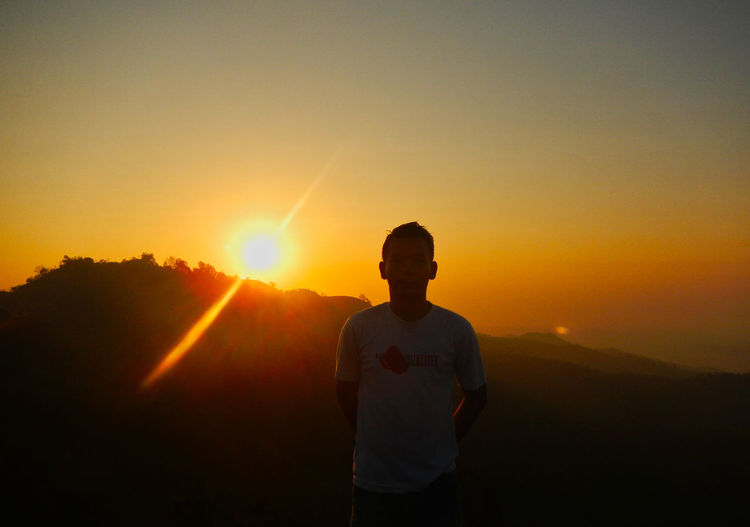 Nglanggeran, Gunung Kidul, Yogyakarta, Indonesia. Sunset Sky One Person Standing Sun Leisure Activity Lens Flare Beauty In Nature Lifestyles Sunlight Orange Color Sunbeam Nature Real People Men Scenics - Nature Silhouette Clear Sky Copy Space Outdoors EyeEm Best Shots Nature Beauty In Nature Enjoying Life EyeEm Selects