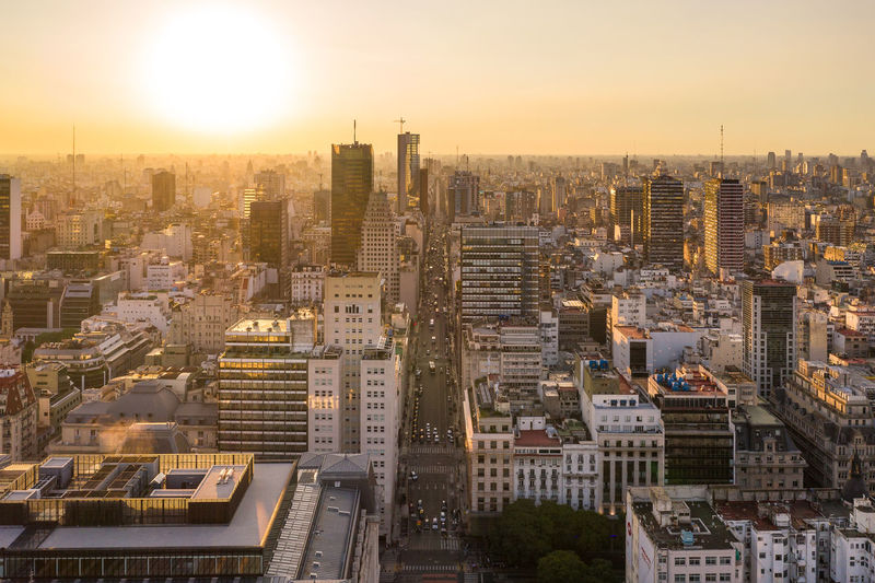 Sunset in Buenos Aires Building Exterior City Architecture Built Structure Cityscape Building Sky Residential District Crowded Nature High Angle View Sunset Skyscraper Office Building Exterior Outdoors City Life Sun Modern Apartment Argentina Buenos Aires Drone  Buenosaires Drone Photography Skyline