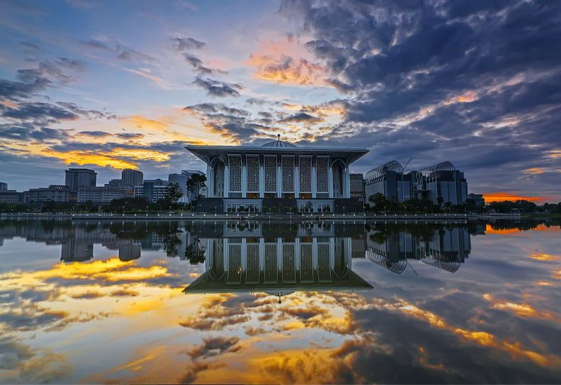 Mosque Tuanku Mizan with sunrise lake reflection Reflection Sunset Reflection Lake Business Finance And Industry Architecture Scenics Tranquility Sky Nature Sea Waterfront Outdoors Water Landscape Night Cityscape Sunrise lake side The City Light