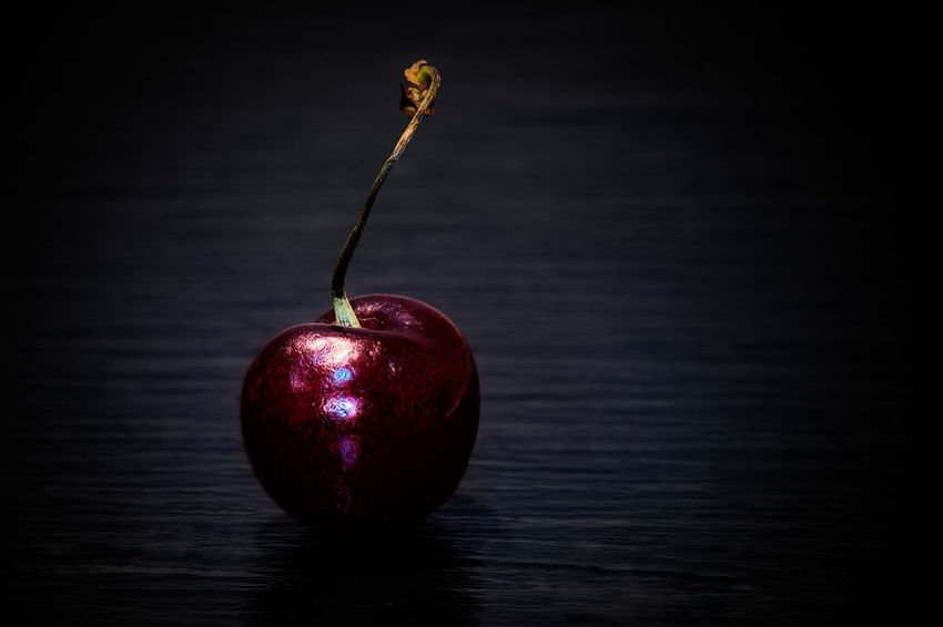 Juicy. Closeup of a cherry on slate. And then I ate it. Black Background Bokeh Cherry Closeup Food Food And Drink Fruit Fruits Light And Shadow Product Photography Studio Shot PENTAX K-1 Food Photography