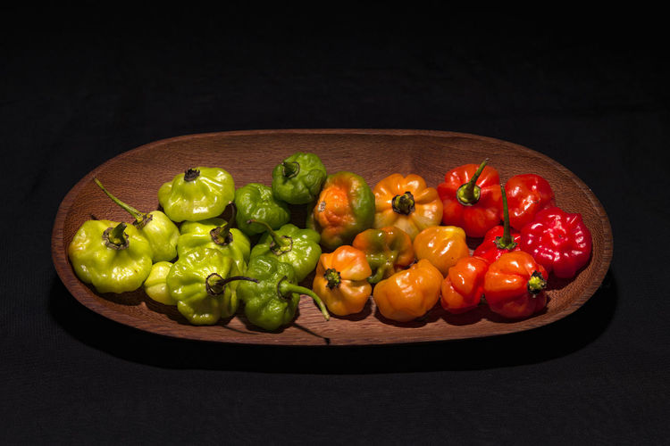 High angle view of fruits and vegetables on black background