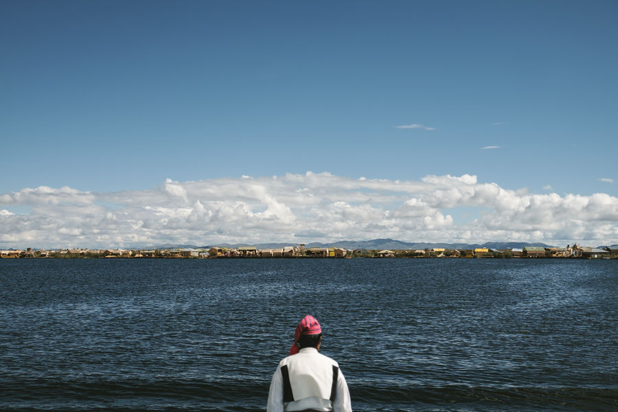 Titicaca Lake. Puno - Perú Admiring The View Andes Cloud - Sky Lake Landscape Lifestyles Nature One Person Outdoors Peru Sky Sky And Clouds Standing Tipical Dress Titicaca