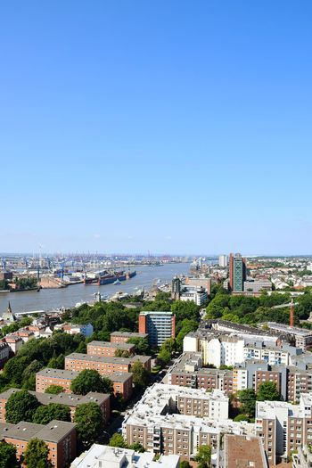 Nature Beauty In Nature Sunlight Sunshine Outdoors Focus On Foreground Have A Nice Day♥ River Elbe ♥️ City Cityscape Water Clear Sky Beach Urban Skyline High Angle View Sky Architecture Skyscraper Skyline Downtown High Rise Downtown District Tall - High Financial District  TOWNSCAPE Tower
