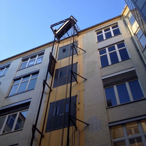 Building Exterior Architecture Window Built Structure Low Angle View Clear Sky Sunlight Outdoors Residential Building No People City Day Sky