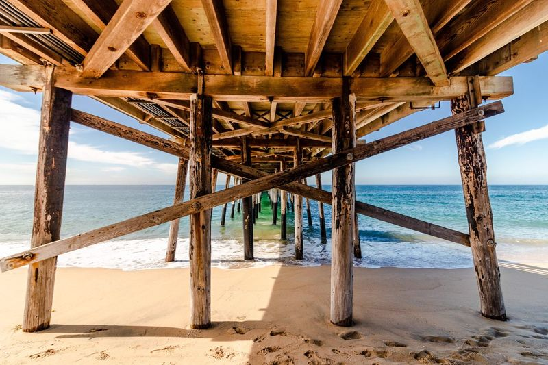 Balboa Pier Sea Beach Water Land Sand Architecture Built Structure Underneath Horizon Horizon Over Water Nature Sky Pier No People Day Below Beauty In Nature Sunlight Scenics - Nature Outdoors