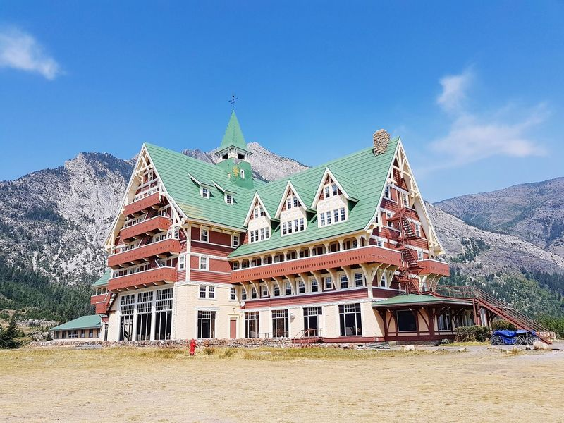 Travel Destinations History Architecture Cloud - Sky Tradition Built Structure Sky Outdoors No People Blue Day Nature Prince Of Wales Hotel Waterton Lakes National Park Alberta