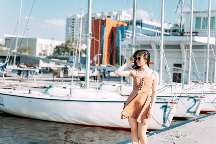 Young woman on sailboat at harbor