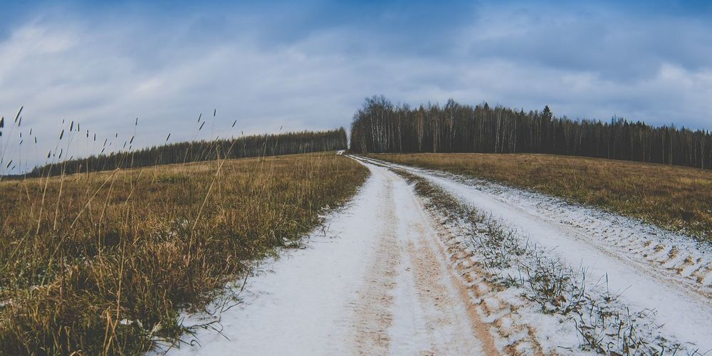 ... The Way Forward Sky Nature Diminishing Perspective Tranquil Scene Tranquility Cloud - Sky Road Grass No People Scenics Landscape Day Outdoors Beauty In Nature Tire Track Cold Temperature Snow Tree