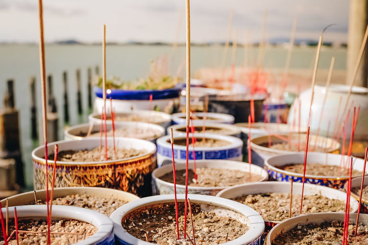 Focus On Foreground Incense Incense Sticks Nature No People Outdoors Religion Rerigion Selective Focus Sky