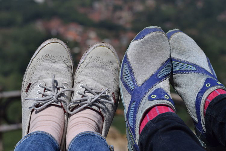 Low section of people wearing shoes outdoors