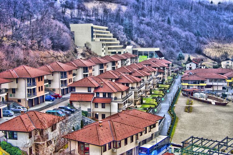 Image of Fojnica from the roof top patio of Aqua Reumal. Architecture Bosnia And Herzegovina Building Exterior Built Structure City City Life Community Crowded Day Fojnica High Angle View House Human Settlement In A Row Jasmin Hrnjic No People Outdoors Residential Building Residential District Residential Structure Road Roof Rooftop Town Tree