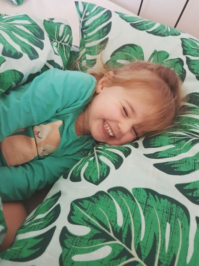 Green Color Happy People One Person Child Lying Down Childhood Portrait One Girl Only Children Only Directly Above Leaf Smiling First Eyeem Photo Toddler  Love Bedtime Bed Adorable Cute Innocent Children Photography Day Real People Joy EyeEmNewHere