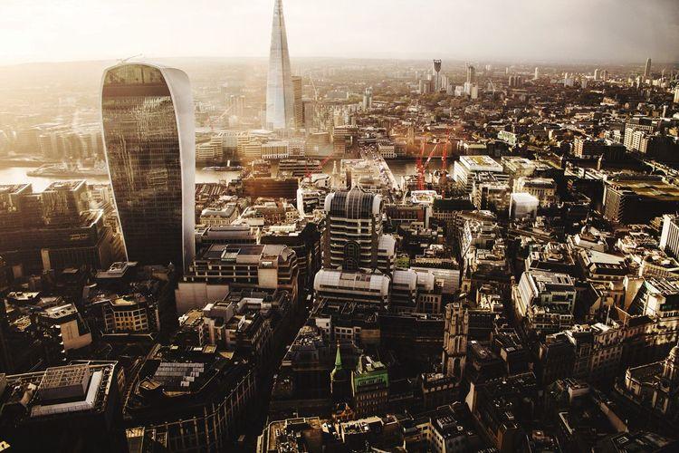 Modern buildings amidst cityscape against sky