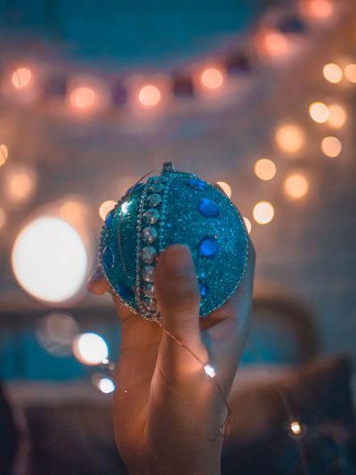 Christmas ornament Human Hand Hand Light Glowing Decoration Christmas Christmas Decoration Christmas Ornament christmas tree Christmas Lights EyeEmNewHere EyeEm Best Shots Light Christmas Tree Lights Lens Flare Fairy Lights Blue Best EyeEm Shot Best Colours
