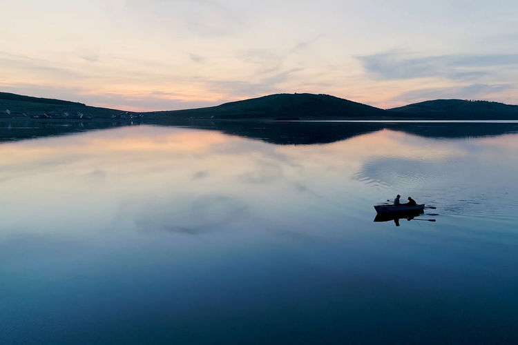 Sky Water Cloud - Sky Scenics - Nature Beauty In Nature Reflection Tranquil Scene Tranquility Waterfront Lake Nature Silhouette Sunset Mountain Idyllic Nautical Vessel Non-urban Scene Transportation Mountain Range
