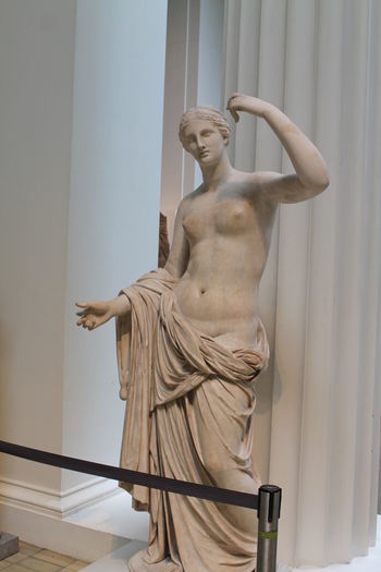 Low angle view of statue against white wall, sculpture, greek, museum.