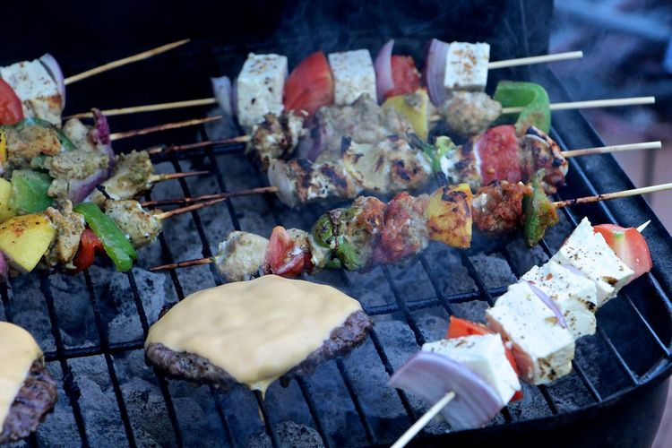 High Angle View Of Skewers And Meat On Barbeque Grill