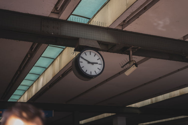 Low angle view of clock on ceiling at railroad station