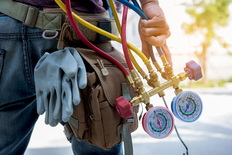 manometers,measuring equipment for filling air conditioners Cable Close-up Complexity Day Focus On Foreground Hand Holding Human Hand Men Midsection Mode Of Transportation Occupation One Person Outdoors Power Supply Real People Standing Technician Technology Working