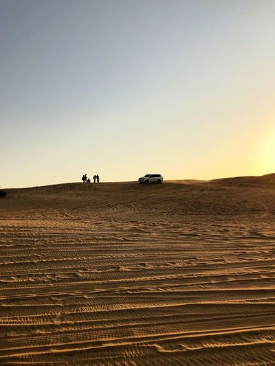 Mode Of Transportation Transportation Desert Clear Sky Scenics - Nature Sunset Off-road Vehicle Beauty In Nature Sunlight Climate Motor Vehicle Arid Climate Environment Group Of People Copy Space