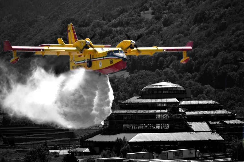 Fire fighting in action Airplane Airport Day Fire Fire Fighter Italy No People Outdoors Sky Water
