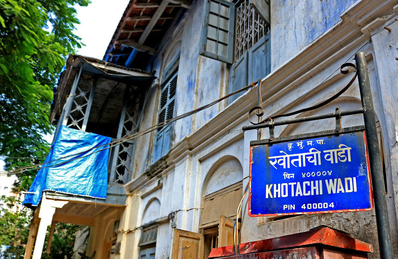 Khotachiwadi in Mumbai, India Architecture Blue Building Exterior Built Structure Chaupati City Communication Day India Low Angle View Mumbai No People Outdoors Road Sign Tree
