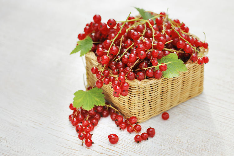 Red Currants in a small wicker basket. Food And Drink Food Freshness Fruit Table No People Berry Fruit Basket Container Large Group Of Objects Red Currant