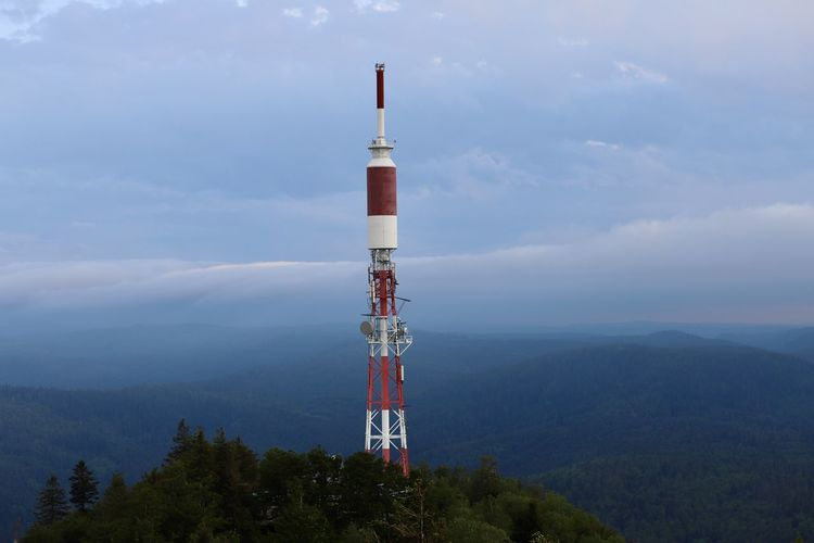 Communications tower against sky