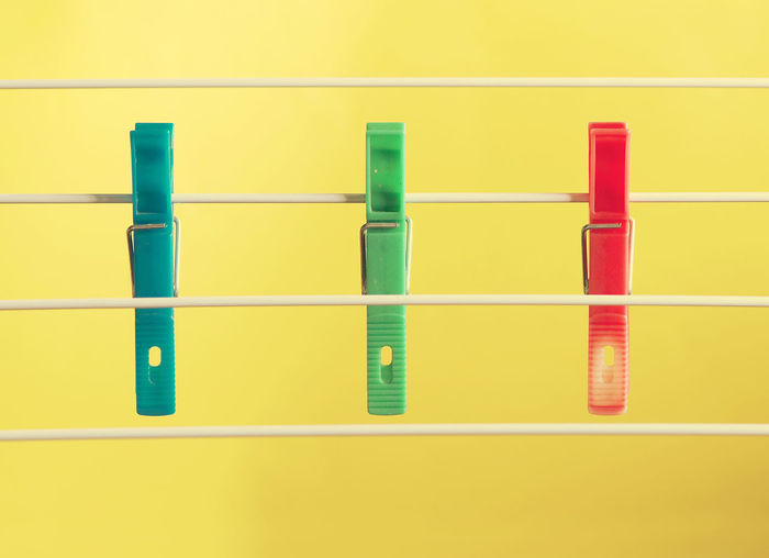 Domestic life... Close-up Clothesline Clothespin Colors In A Row Indoors  Plastic Red Still Life