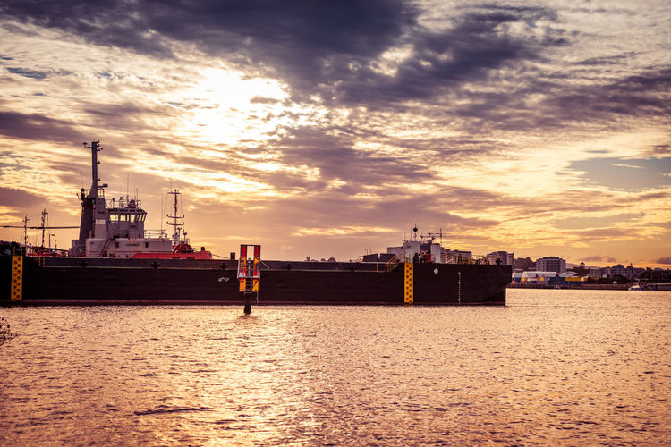 Cloud - Sky Sky Water Sunset Waterfront Architecture Industry Nautical Vessel Built Structure Nature Sea Transportation Building Exterior Freight Transportation No People Shipping  Outdoors Business Ship