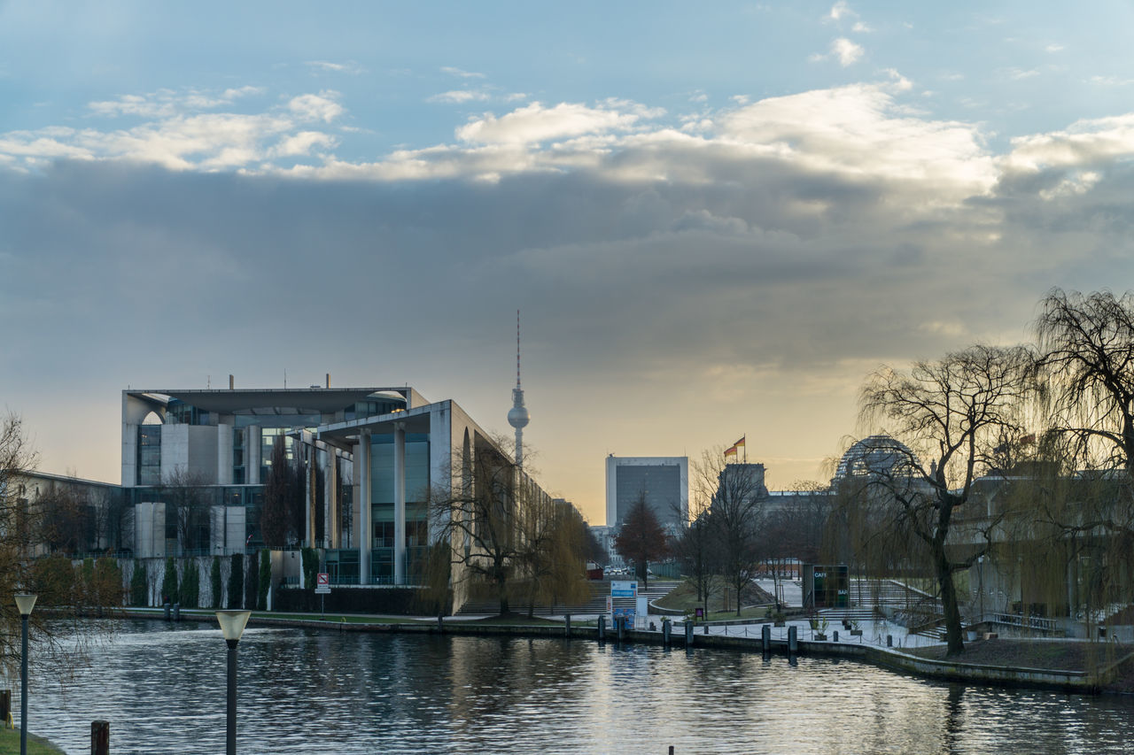 architecture, building exterior, built structure, sky, cloud - sky, water, no people, waterfront, outdoors, day, bare tree, city, nature, tree
