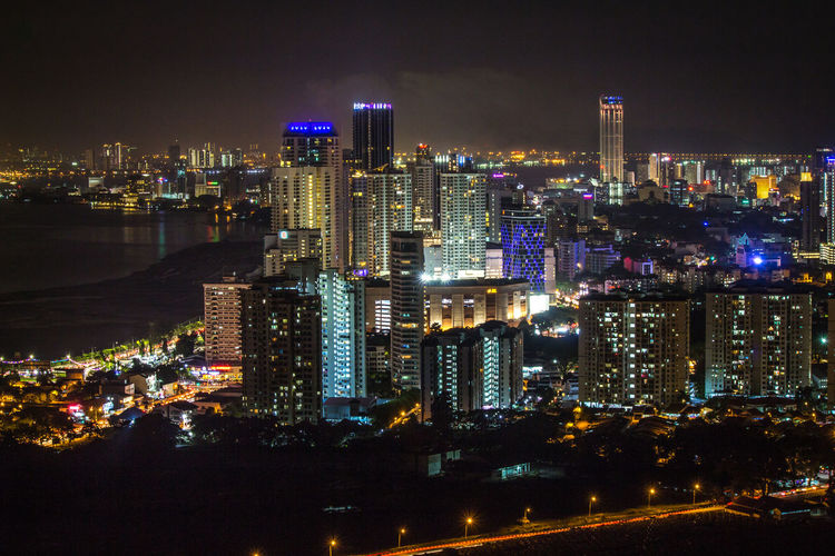 Nightscaping featuring the skyline of Penang island, Malaysia City Building Exterior Night Illuminated Architecture Built Structure Cityscape Building Office Building Exterior Residential District City Life Skyscraper Modern Urban Skyline Landscape Water Sky Travel Destinations No People Outdoors Dark Financial District  Nightlife Light Luminosity