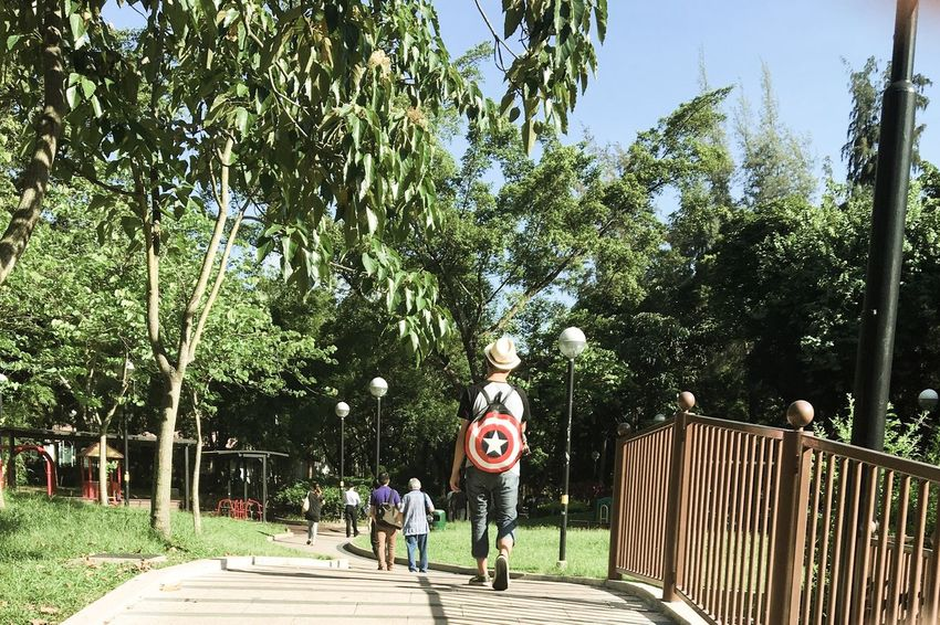 Streetphotography Streetphoto_color Snapshots Of Life Summer Summertime Summer Views Morning Morning Light Sunshine Cinematic Captainamerica Hat Boy View From Behind Trees TreePorn Park Walk Walk This Way Light And Shadow Backpack Shield Natural Light Portrait Showcase June