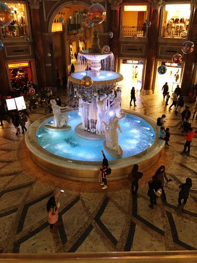 Fountain Bluewater Crowd Japan Tokyo Upstairs Stone Floor Warm Light Statue Arch Solar System Pattern Store 3layers Shopping Mall Snapshot Brown White Clothes Tourist White Light Ball Cafe Flowerpot Marble