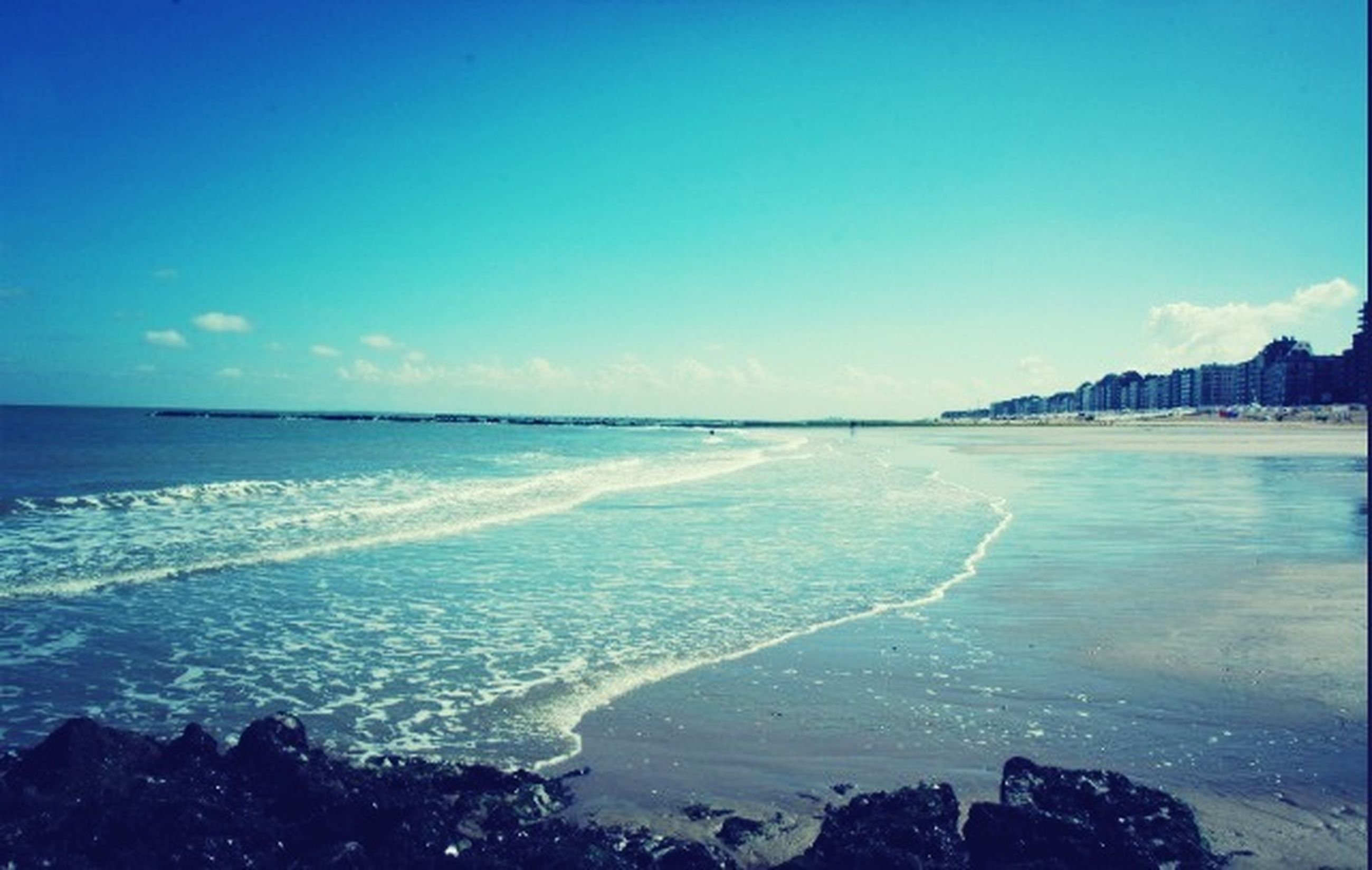 sea, water, horizon over water, scenics, blue, tranquil scene, beauty in nature, tranquility, nature, copy space, sky, clear sky, coastline, beach, idyllic, shore, seascape, outdoors, day, high angle view