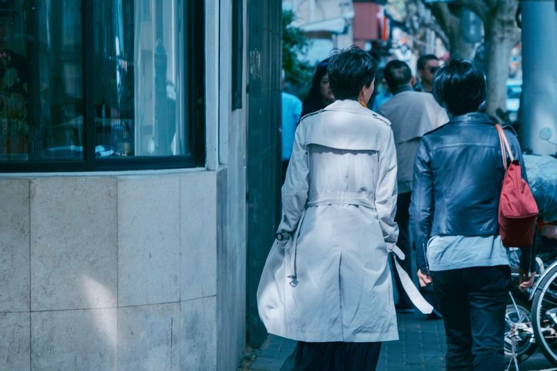 Women City Rear View Architecture Street Adult People Walking Real People Two People City Life Lifestyles Building Exterior Built Structure Clothing Three Quarter Length Men Togetherness Day Casual Clothing