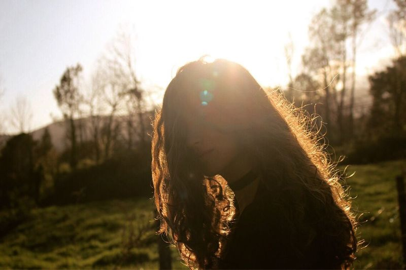 SHADES Focus On Foreground Close-up Long Hair One Person Headshot Outdoors Sunlight Day Nature Real People Women Sky People Rear View Forest Silhouette Nature Spirituality Beauty In Nature Standing Young Adult Young Women Clear Sky
