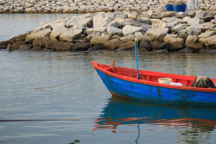 Boats moored at shore