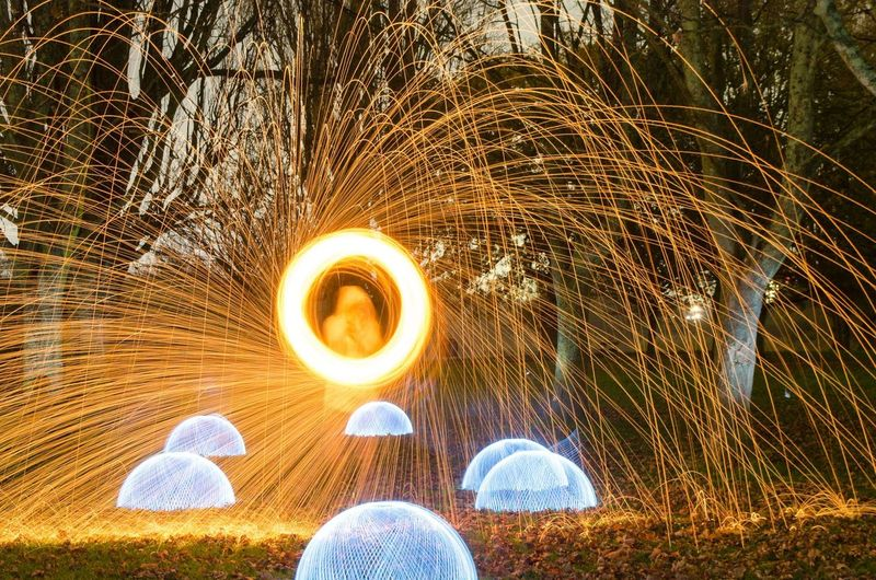 Nikon Blurred Motion Burning Fire Fire - Natural Phenomenon Glowing Heat - Temperature Illuminated Land Light Long Exposure Motion Nature Night One Person Orange Color Outdoors Plant Real People Sparks Spinning Wire Wool