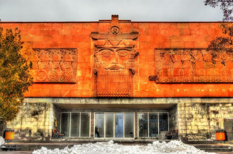 Exterior of building against orange sky