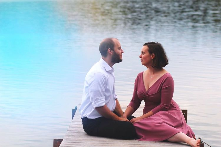 Couple sitting on shore