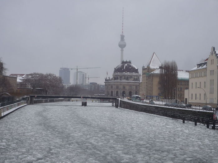 Architecture Building Exterior Built Structure City Cityscape Cultures Day Frozen River Ice Museumsinsel No People Outdoors River Spree Sky Snowing Tower Travel Destinations Water Winter