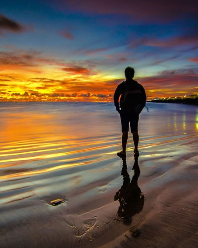 Lost In The Landscape alone Water Sunset Sea Sky One Person Silhouette Real People Cloud - Sky Reflection Horizon Over Water Outdoors Tranquil Scene Rear View