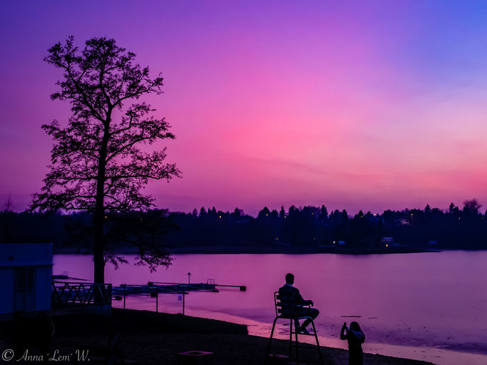 Purple sunset over the lake. Tree Sky Silhouette Sunset Beauty In Nature Water Plant Nature Real People Lake Scenics - Nature One Person Tranquility Tranquil Scene Orange Color Dusk Idyllic Cloud - Sky Outdoors Purple The Week on EyeEm EyeEm Best Shots EyeEm Nature Lover EyeEm Masterclass