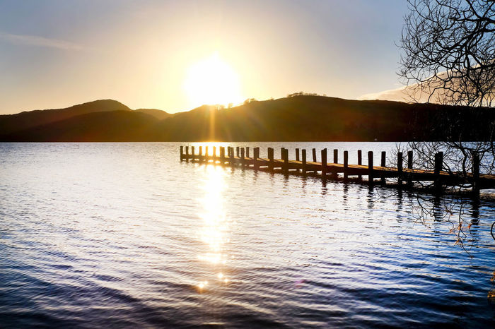 Architecture Beauty In Nature Clear Sky Coniston Water Day Jetty Jetty View Lake Lens Flare Mountain Mountain Range Nature No People Outdoors Reflection Scenics Silhouette Sky Sun Sunlight Sunset Tranquil Scene Tranquility Water Waterfront