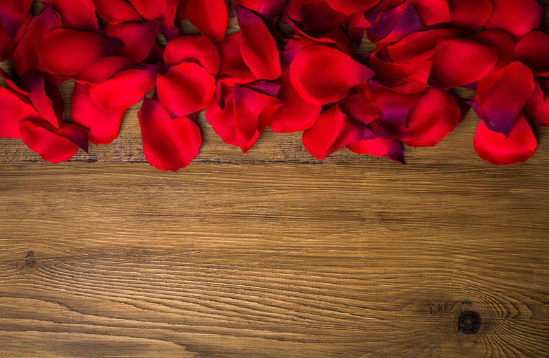 Directly above view of red rose petals on table