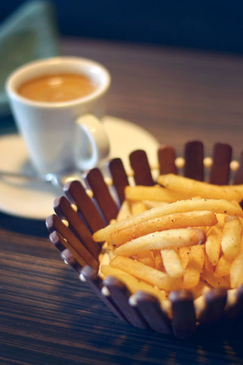 coffee at the cafe with food fries Food And Drink Cup Coffee Coffee Cup Fast Food Unhealthy Eating Drink Ready-to-eat Coffee - Drink Prepared Potato Table Refreshment French Fries Food Potato Still Life Fried Mug No People Crockery Close-up Freshness Snack Fast Food French Fries French Food