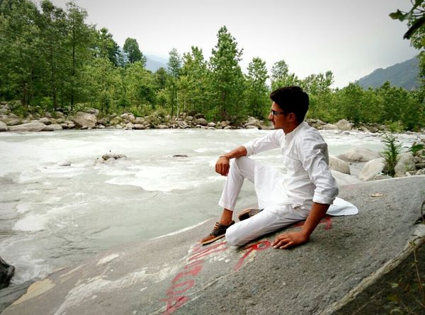 Live For The Story Sitting One Man Only Adult One Person Adults Only Water Only Men Men People Sand Outdoors Full Length Tree Nature Day Beach Sky Manali. ManaliMoments EyeEmNewHere
