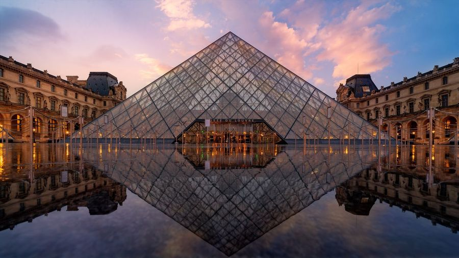 Been There. visited paris last weekend and it was amazing. managed to get this shot early in the morning before the museum gets crowded. Reflection Pyramid Architecture Sky History Triangle Shape Travel Destinations Built Structure WaterEyeEm Masterclass Today's Hot Look Outdoors No People City Louvre Museum Sunrise Cityscape Lost In The Landscape