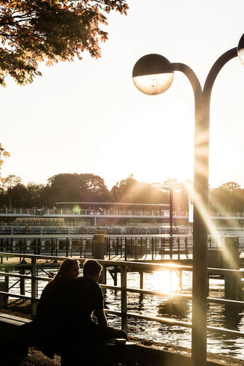 sunset lovers Couple Lovers Sillhouette Sonyalpha Harbour Pier Lake View Sunset Silhouettes Flare Autumn Autumn colors Sky Nature Sunlight Tree Architecture Plant Back Lit Silhouette Day Outdoors Sunset Water Built Structure People Lens Flare Railing City A New Beginning